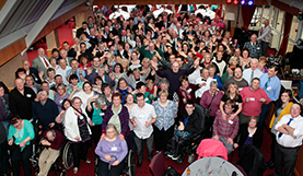 A group of people who have learning disabilities posing for the camera