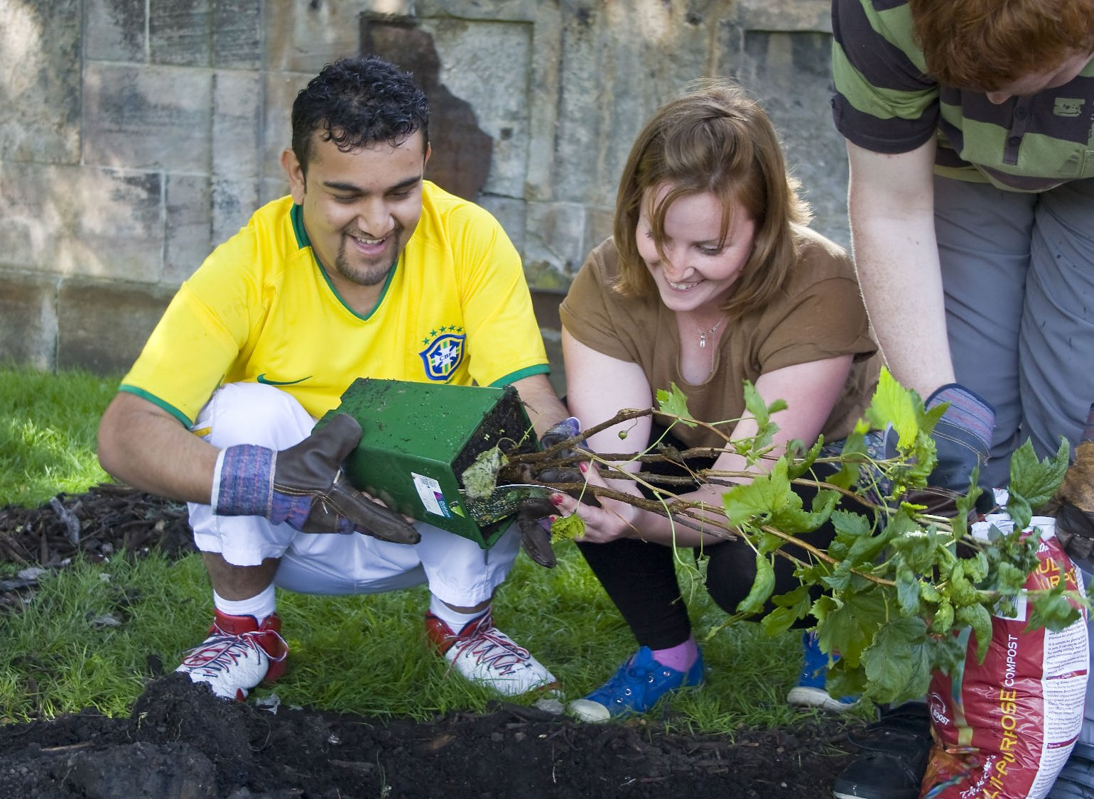 A man who has a learning disability being supported to do gardening