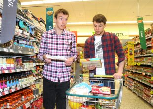 A man who has a learning disability being supported by his personal assistant to do shopping