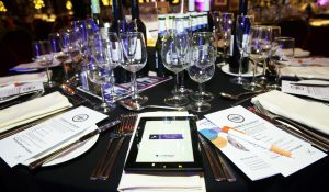 A photo of a table at a black tie event