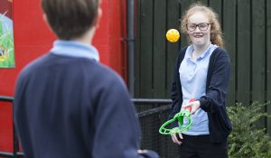 Two school children who have learning disabilities playing sports
