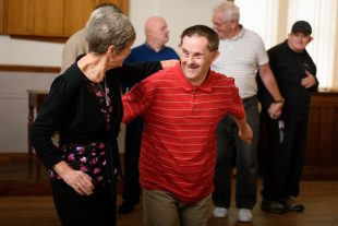 A man who has a learning disability dancing with a female instructor