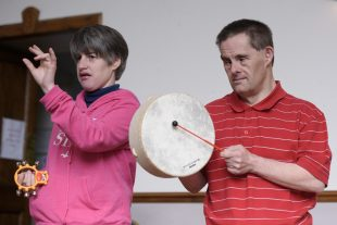 A woman and a man who have learning disabilities playing instruments