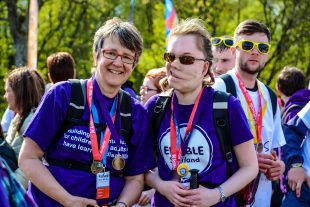 Two women pose for the camera at a charity walk