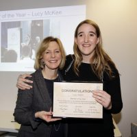 A young woman who has a learning disability accepting an award from a sports presenter