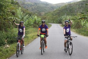 A group of charity cyclists on the road in Madagascar