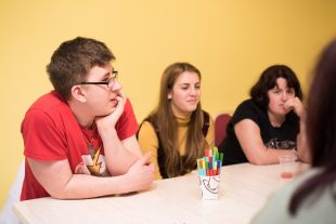 A group of people who have learning disabilities sitting around a table