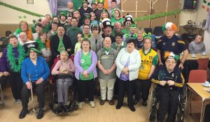 People who have learning disabilities posing for the camera during St Patrick's day celebrations