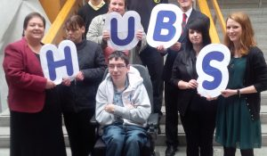 People who have learning disabilities, school pupils and representatives from the government being photographed as they launch a charity campaign