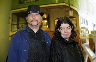 A man and a woman who have learning disabilities posing for the camera at a charity campaign launch event