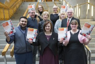 ENABLE Scotland's Picking up the Pieces posing with Emergency Planning Toolkits at the Scottish Parliament