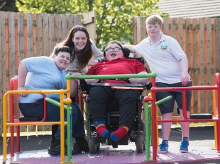 Photo of a group of children who have a learning disability at the playground of our RASCALS service