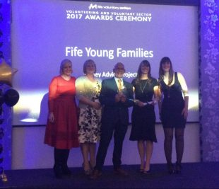 Fife Young Families Money Advice Project receiving an award