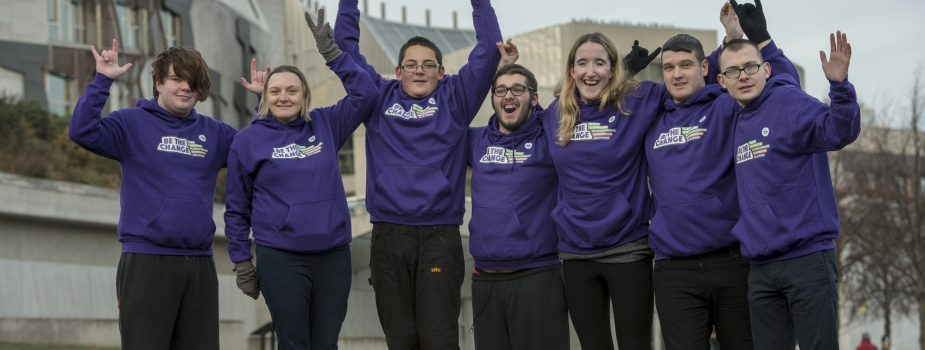 ENABLE Scotland's young Change Champions posing for the camera outside Scottish Parliament